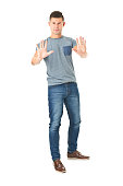 full lenght picture of young handsome man in jeans