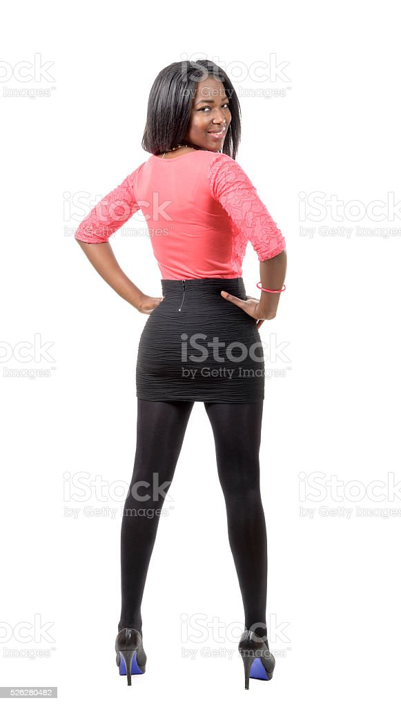 full length beautiful African girl from back stock photo
