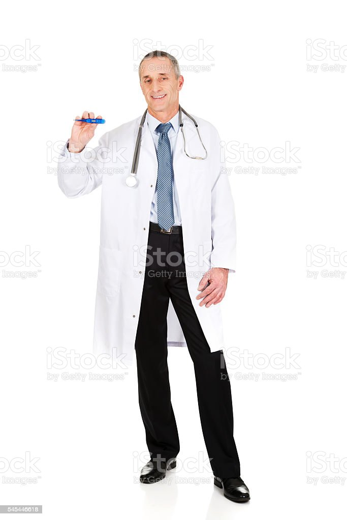 Full length male doctor holding a thermometer stock photo