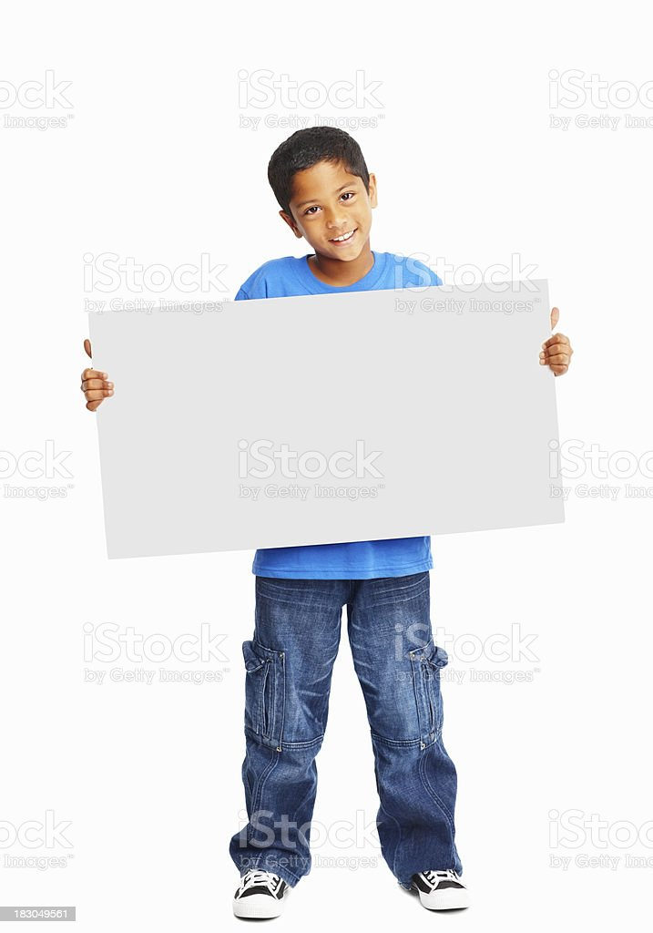 Full length of a happy child holding banner against white stock photo