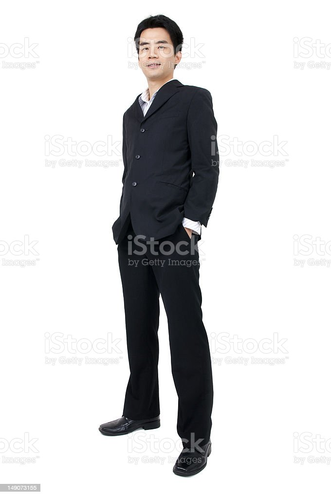 Full length of a smiling young Asian executive royalty-free stock photo