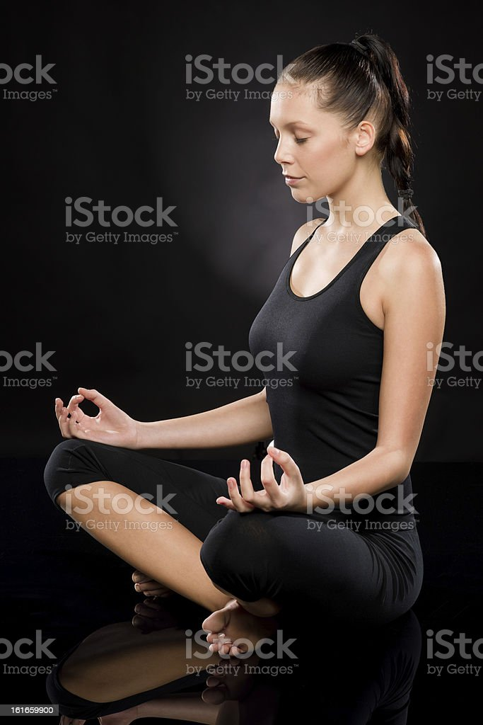 Full length of a young woman meditating royalty-free stock photo