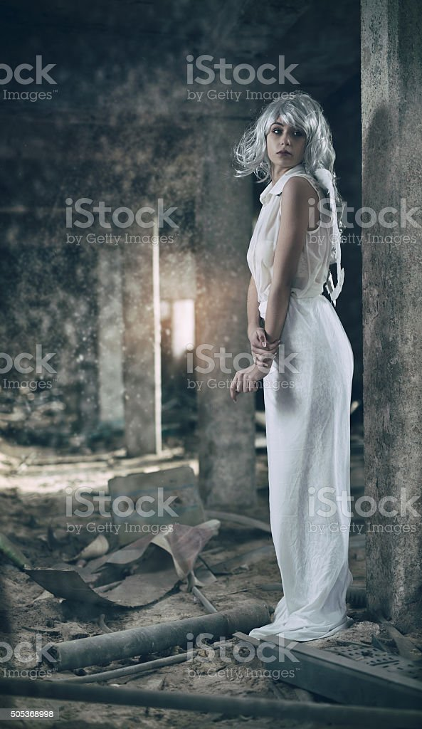 Full length of an angel in a ruin. stock photo