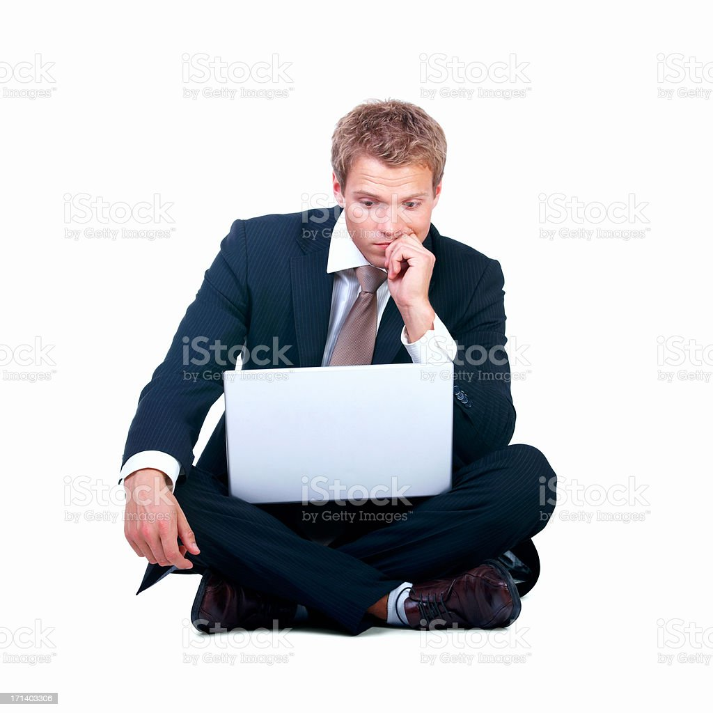 Full length of handsome young man looking at laptop royalty-free stock photo