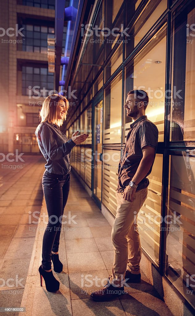 Full length of happy business couple talking to each other. stock photo