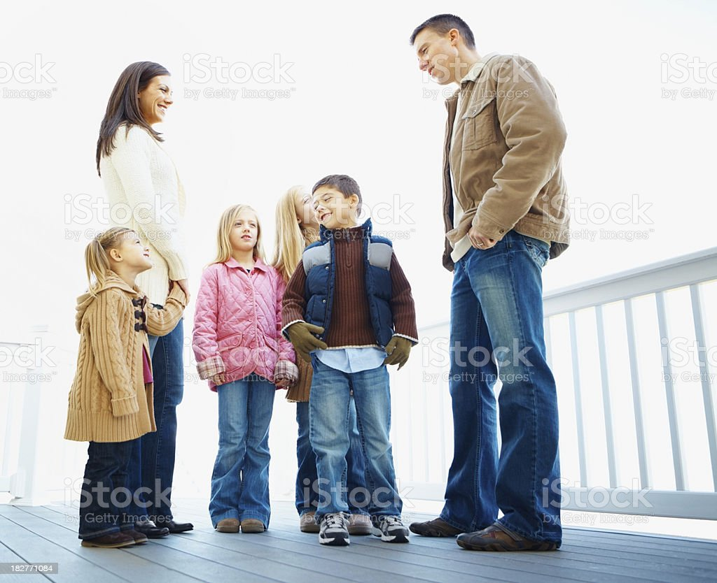 Full length of happy family at a porch royalty-free stock photo