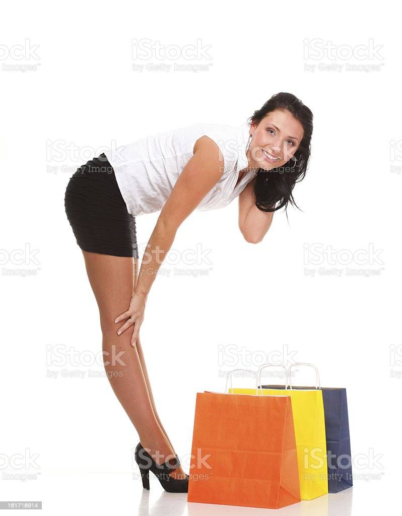 Full length of happy young lady shopping bags against isolated royalty-free stock photo