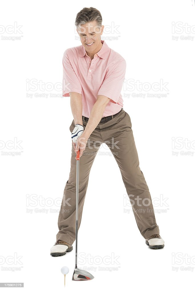 Full Length Of Mature Man Playing Golf royalty-free stock photo