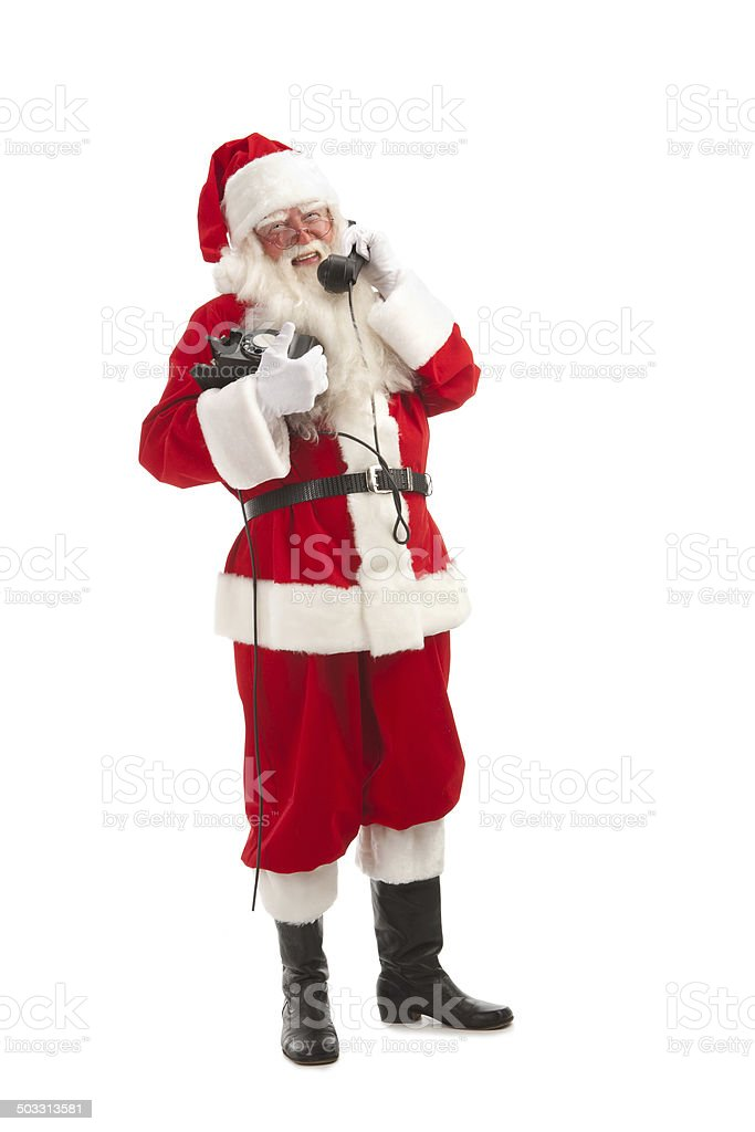 Full Length of Santa Speaking on the Phone . royalty-free stock photo