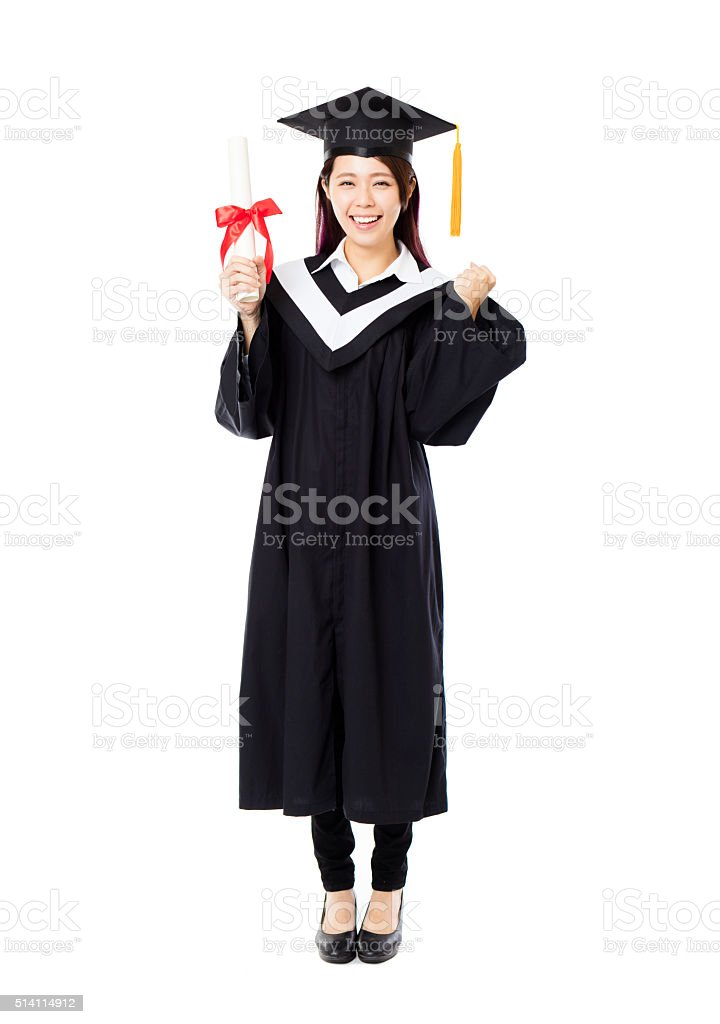 full length of  young female college graduation stock photo