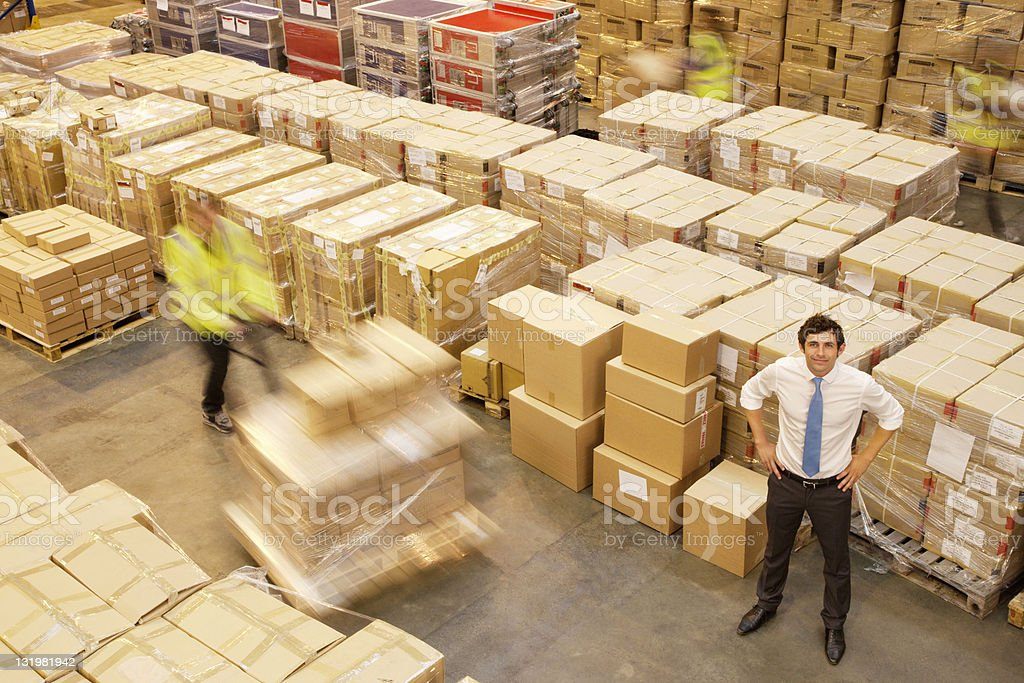 Full length of young manager in warehouse stock photo