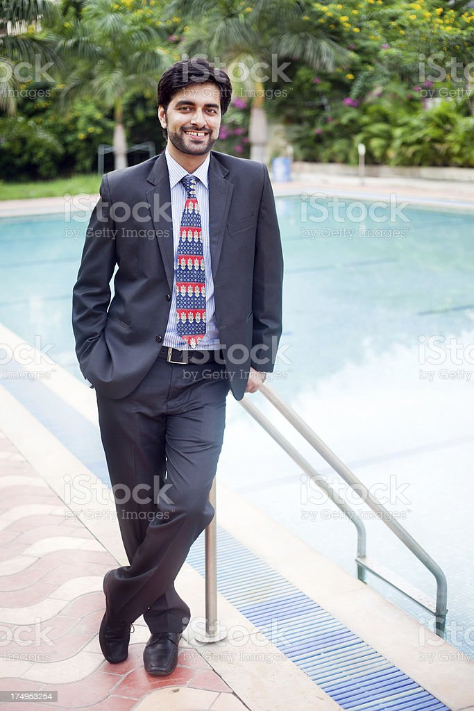 Full Length Outdoor Portrait of Cheerful Handsome Asian Indian Businessman royalty-free stock photo