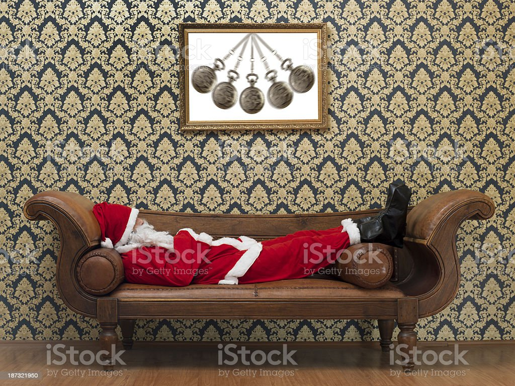 Full Length Photo Of Santa Claus Lying On Psychiatrist's Couch royalty-free stock photo
