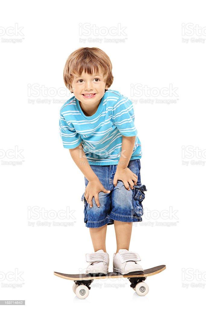 Full length portrait of a boy riding skateboard royalty-free stock photo
