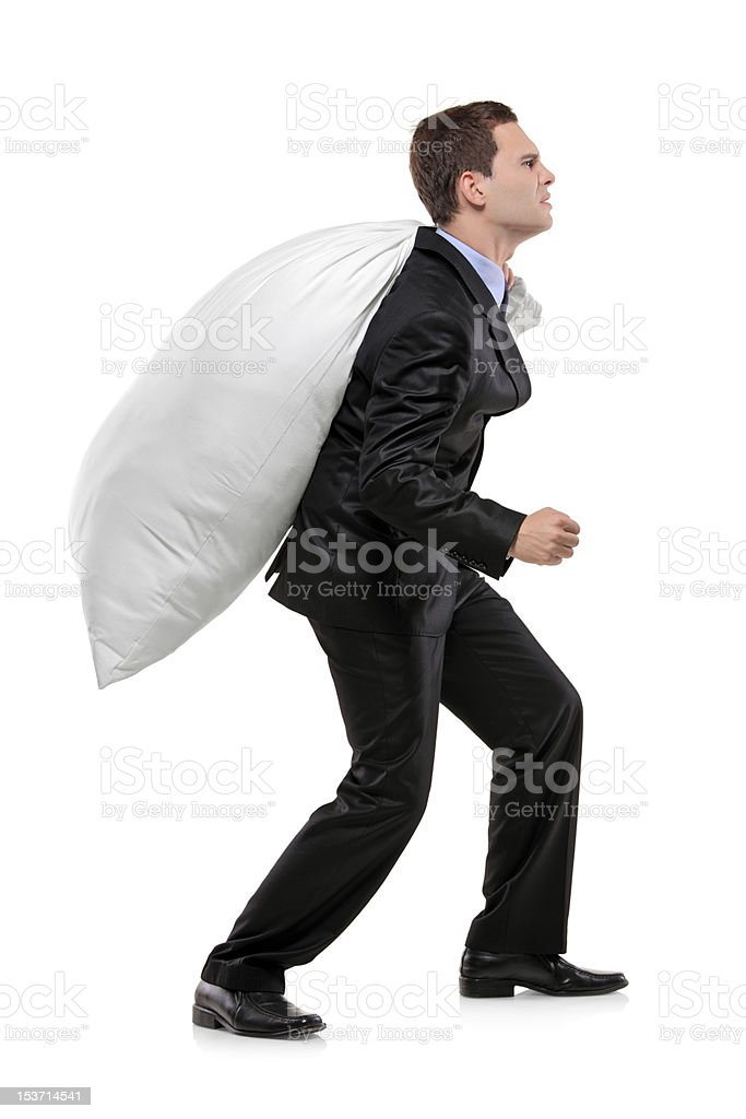 Full length portrait of a businessman carrying money bag royalty-free stock photo