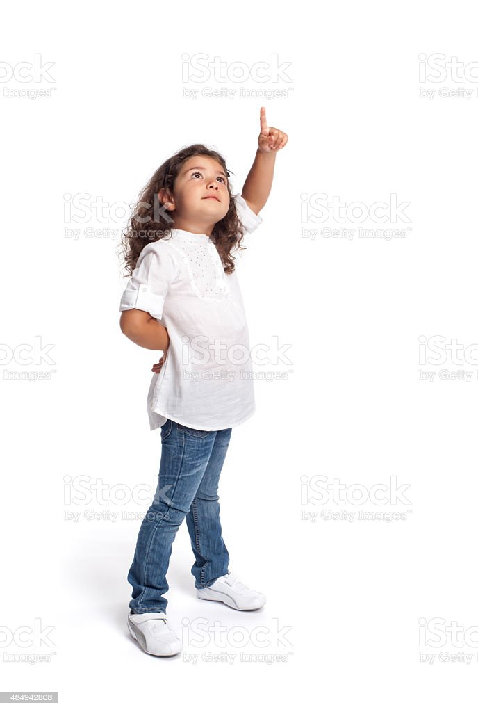 Full length portrait of a happy little girl on white stock photo