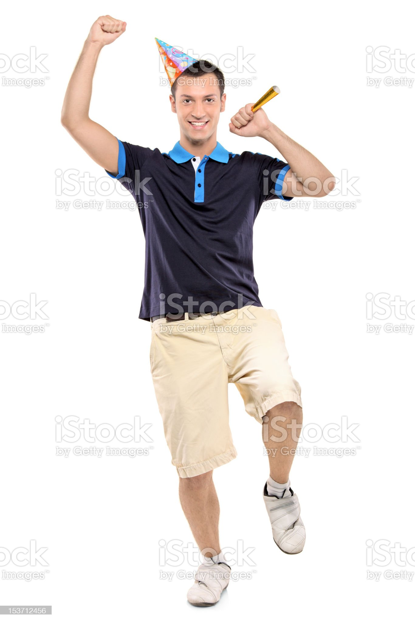 Full length portrait of a happy man wearing party hat royalty-free stock photo