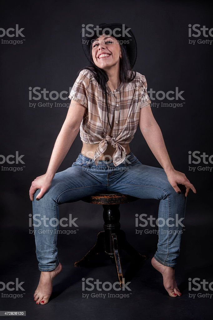 Full length portrait of a laughing cowgirl stock photo