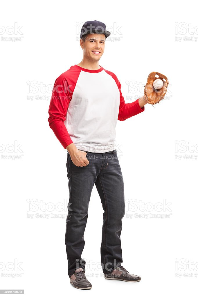 Full length portrait of a young man holding a baseball and looking at...