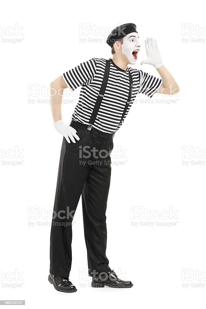 Full length portrait of a mime artist shouting stock photo