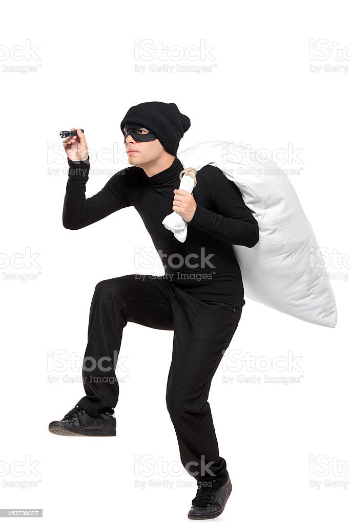 Full length portrait of a robber with bag royalty-free stock photo