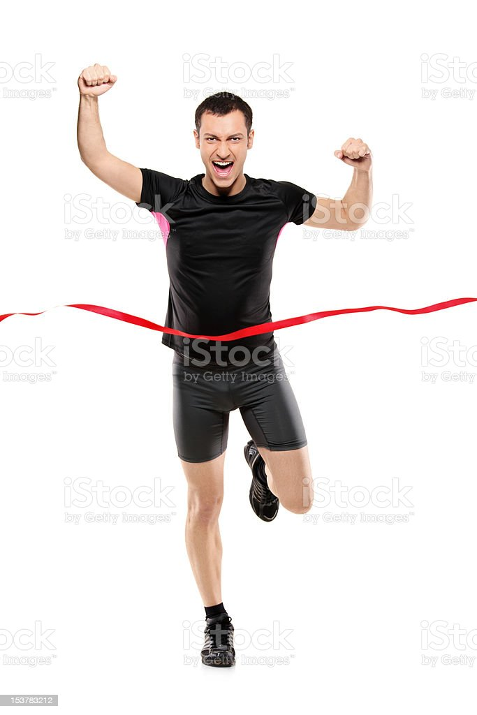 Full length portrait of a runner at the finish line stock photo