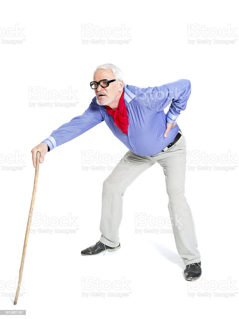 Full length portrait of a senior man walking with cane stock photo