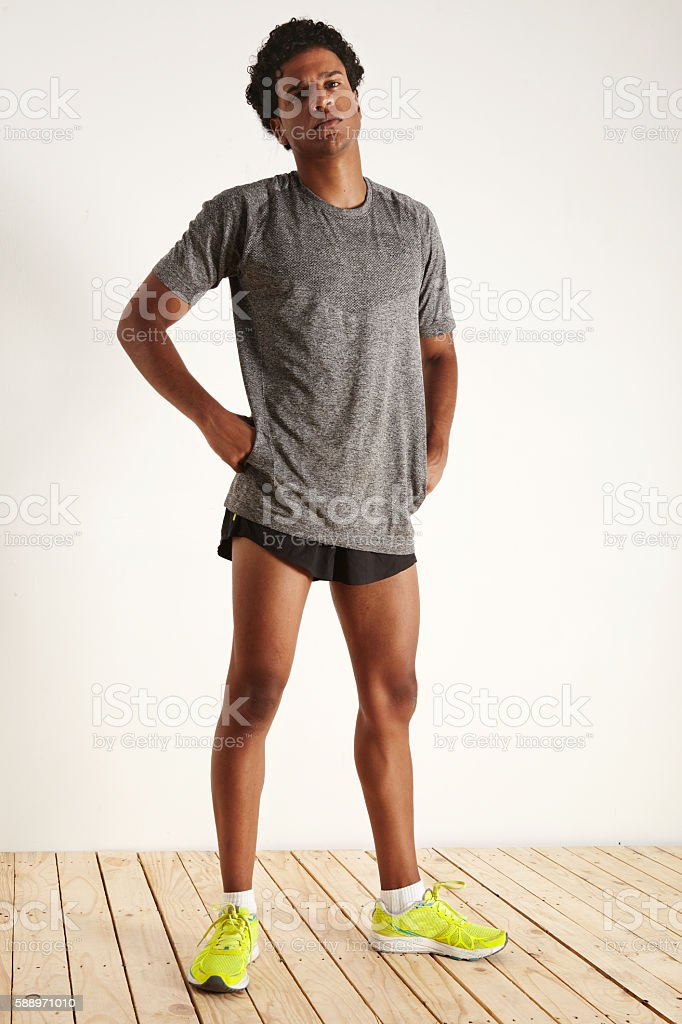 Full length portrait of a tired muscular black athlete stock photo