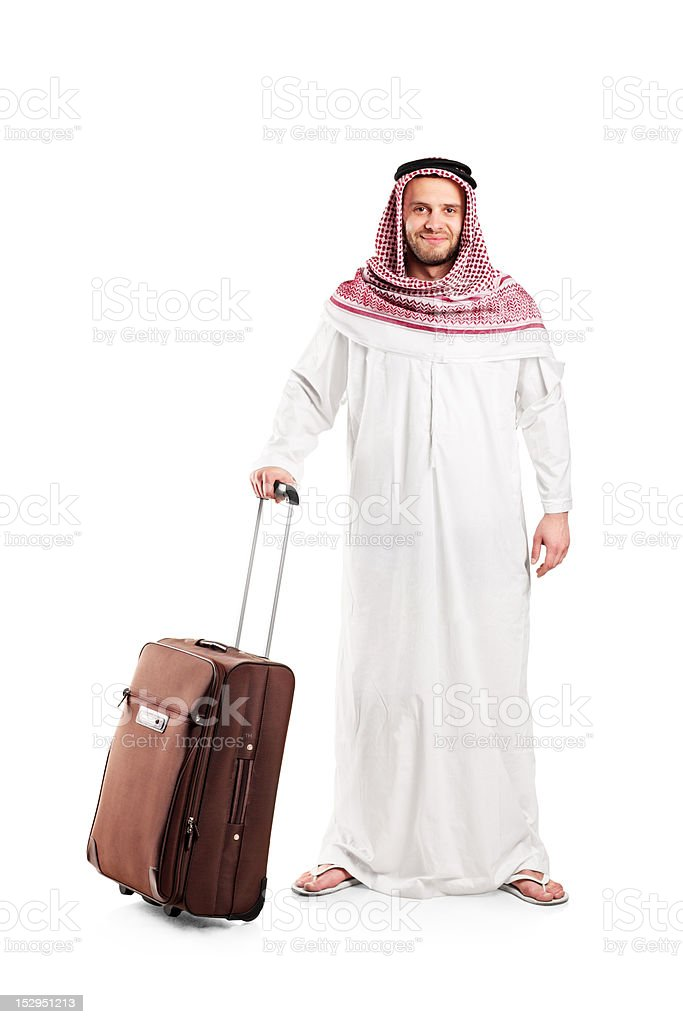 Full length portrait of an Arab carrying a suitcase royalty-free stock photo