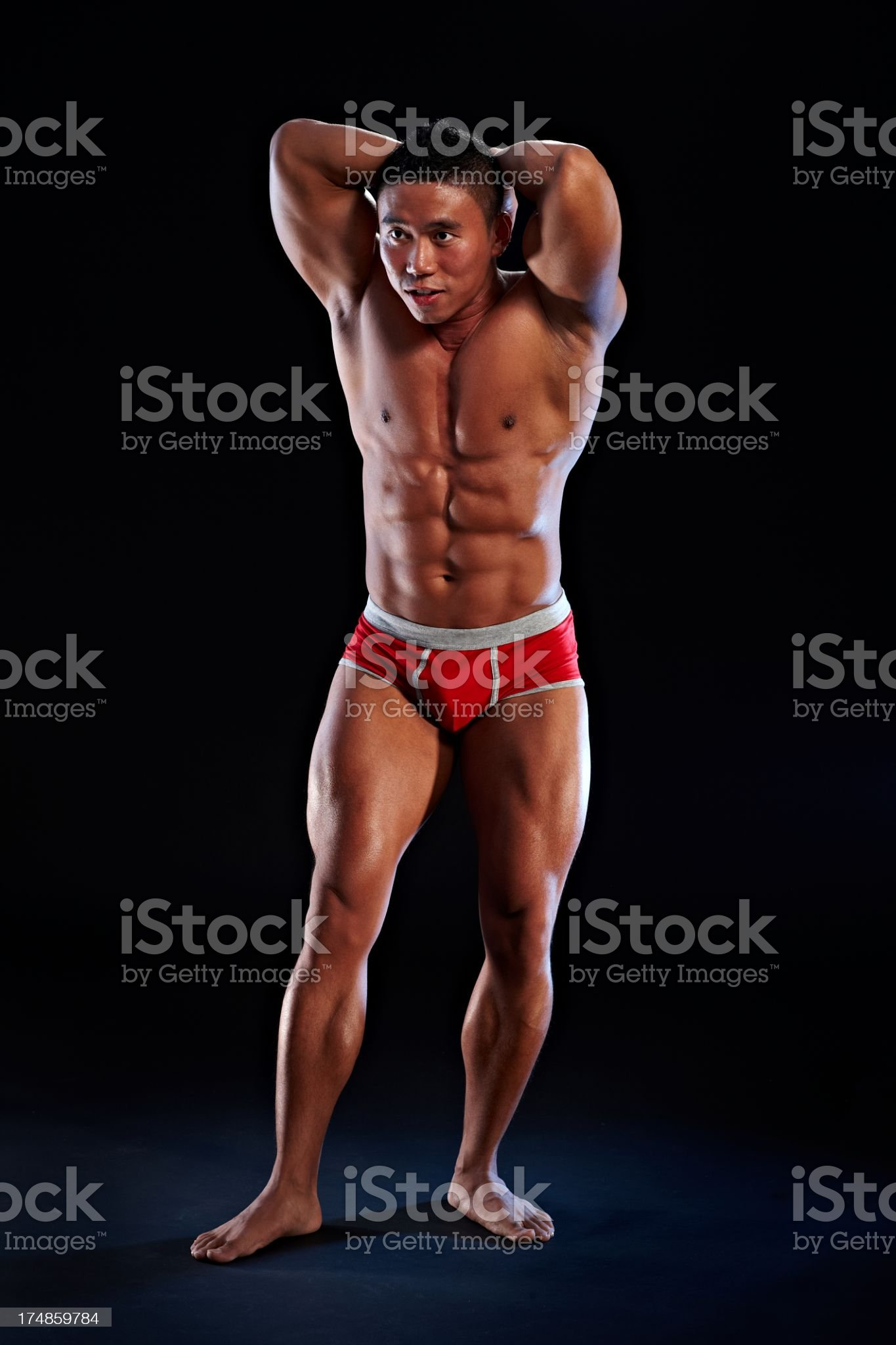 Full length portrait of asian male body builder royalty-free stock photo