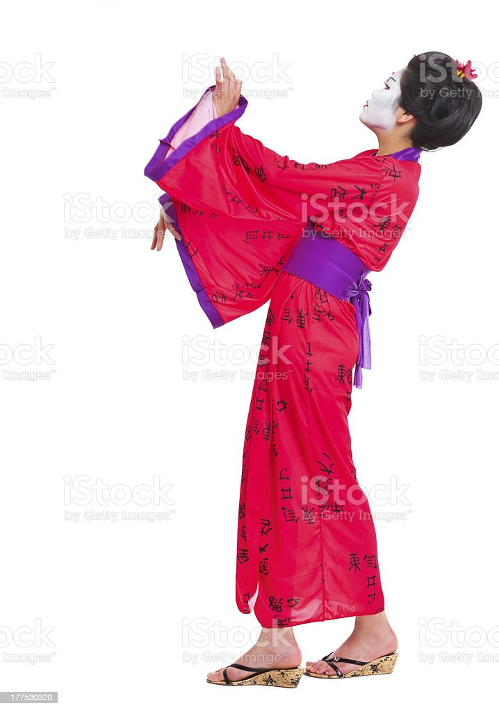 Full length portrait of geisha dancing isolated on white royalty-free stock photo