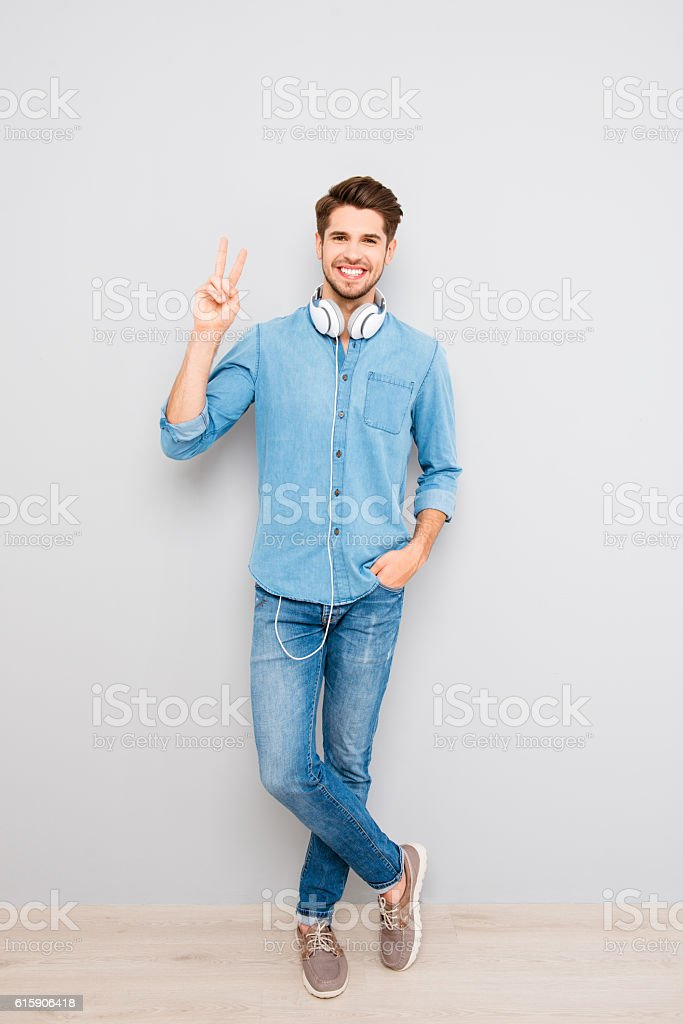 Full length portrait of happy  man  with headphones stock photo