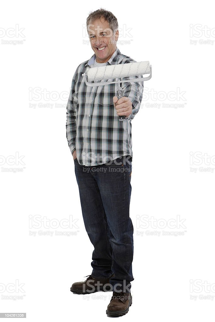 Full length portrait of happy mature man holding paint roller royalty-free stock photo