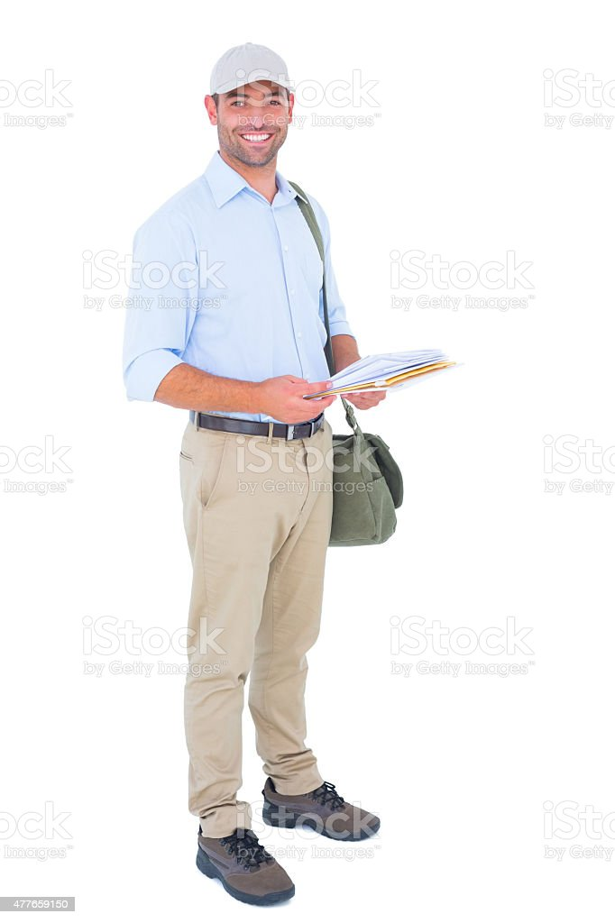 Full length portrait of happy postman with letters stock photo
