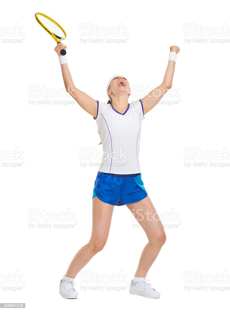 full length portrait of happy tennis player rejoicing in success stock photo