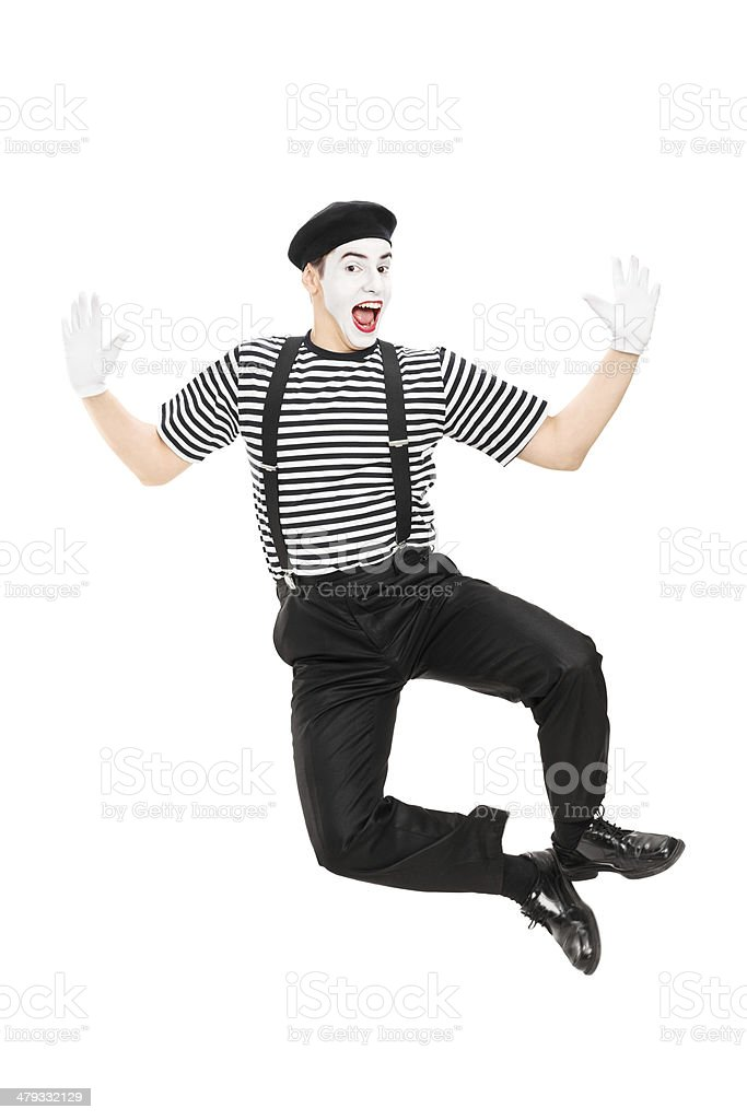 Full length portrait of mime artist jumping with joy stock photo