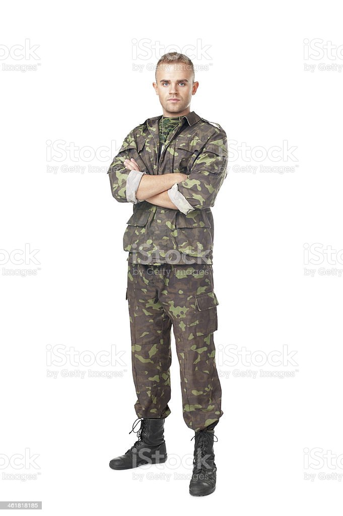 Full length portrait of serious army soldier with arms cross stock photo