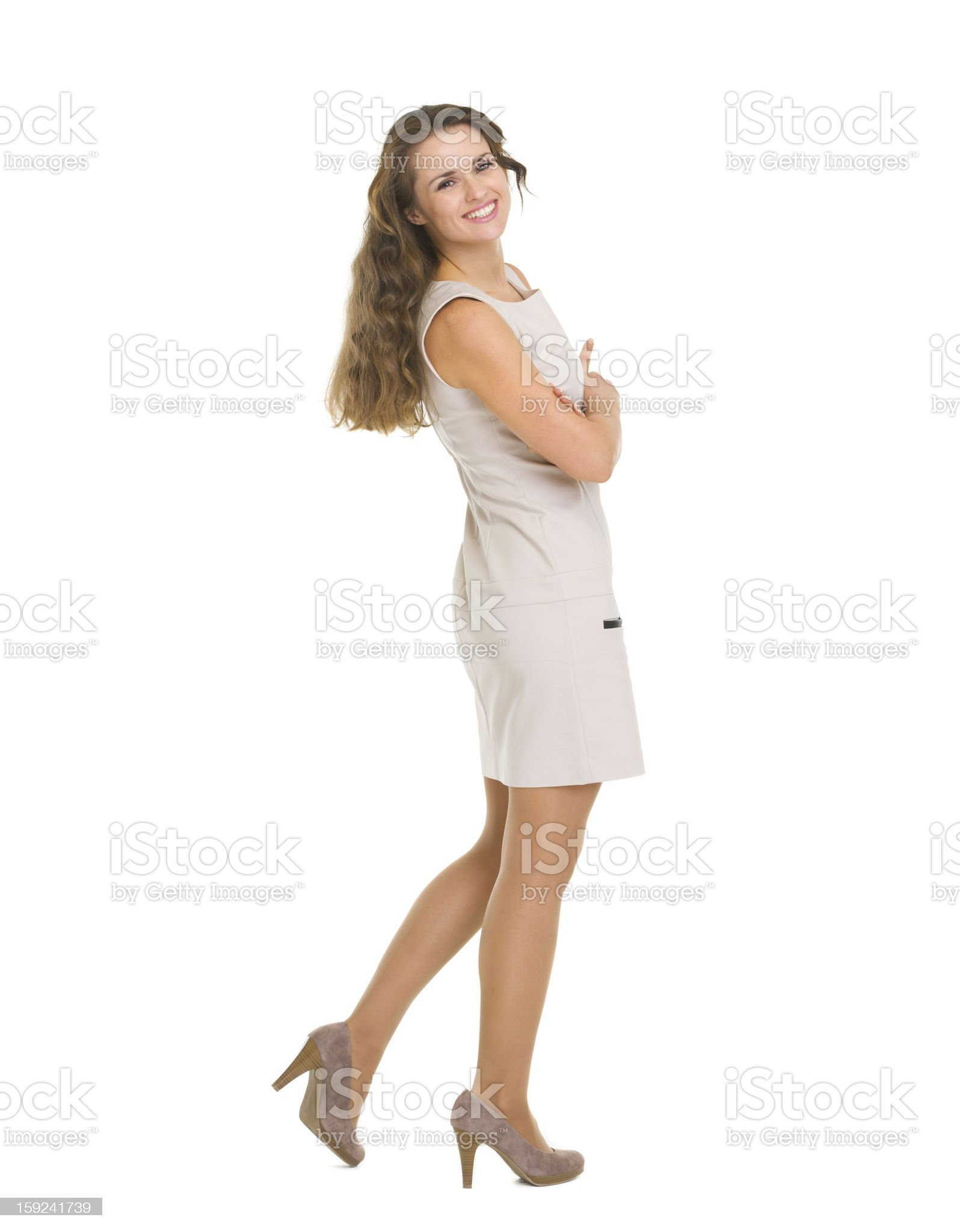 Full length portrait of smiling young woman in dress royalty-free stock photo