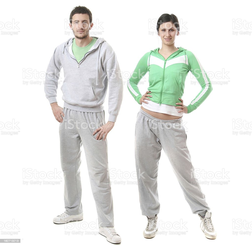 Full length portrait of sporty couple isolated on white royalty-free stock photo