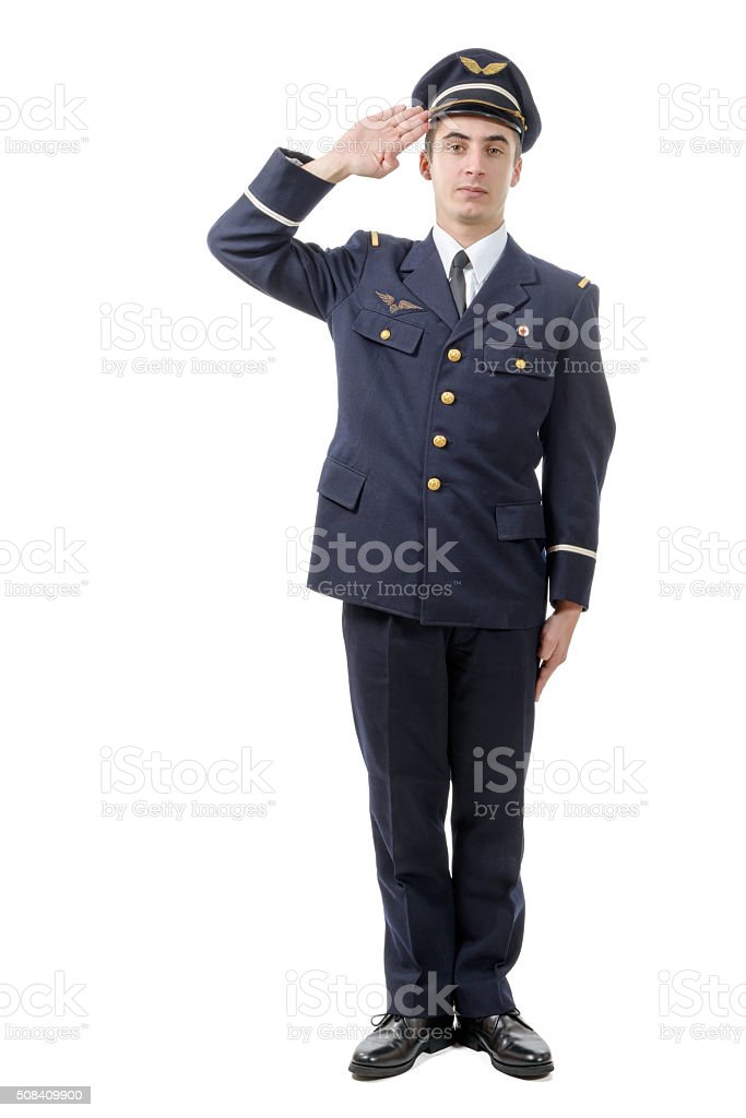 Full length portrait of young army officer saluting isolated on stock photo