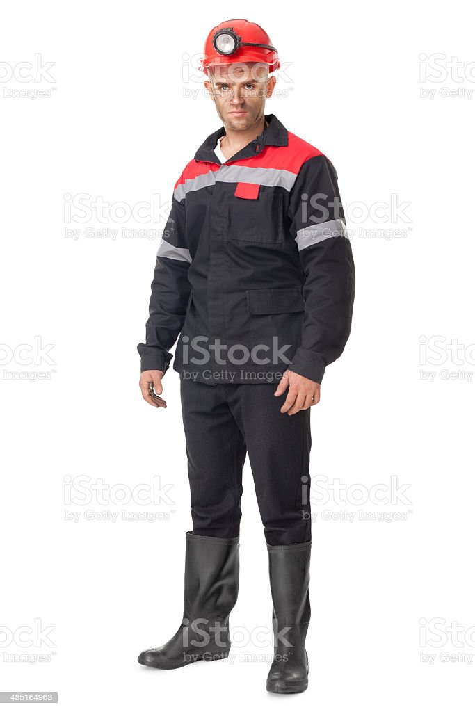 Full length portrait of young coal miner stock photo