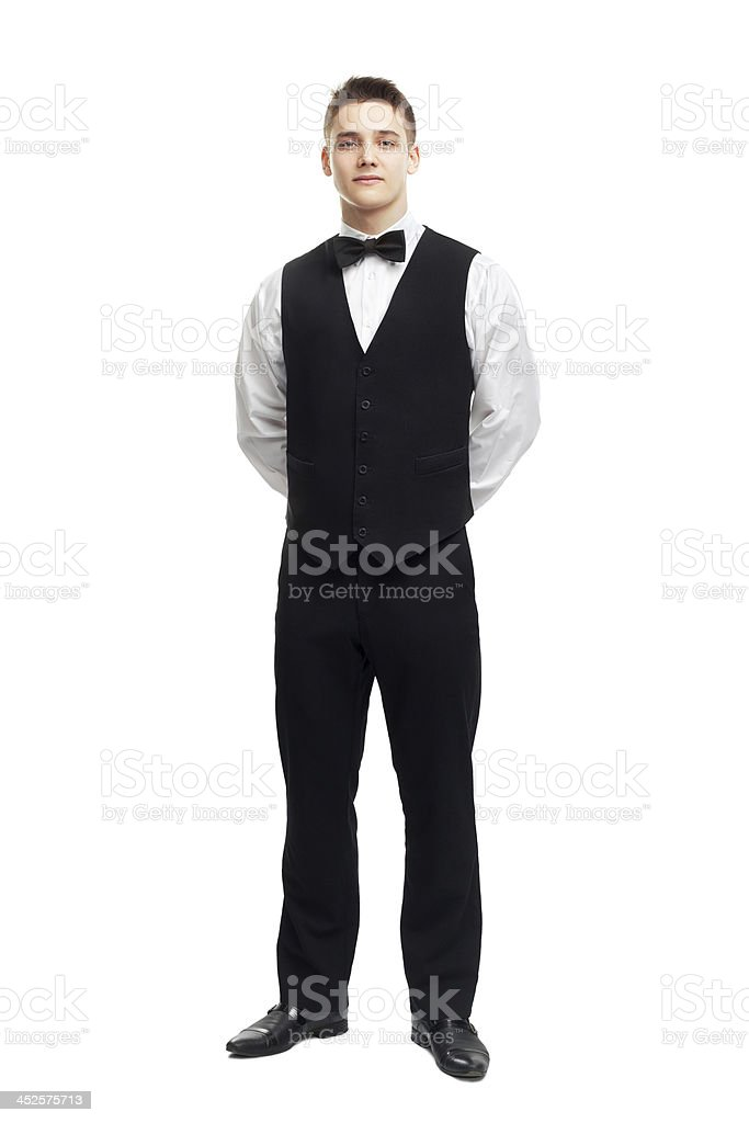 Full length portrait of young smiling waiter stock photo
