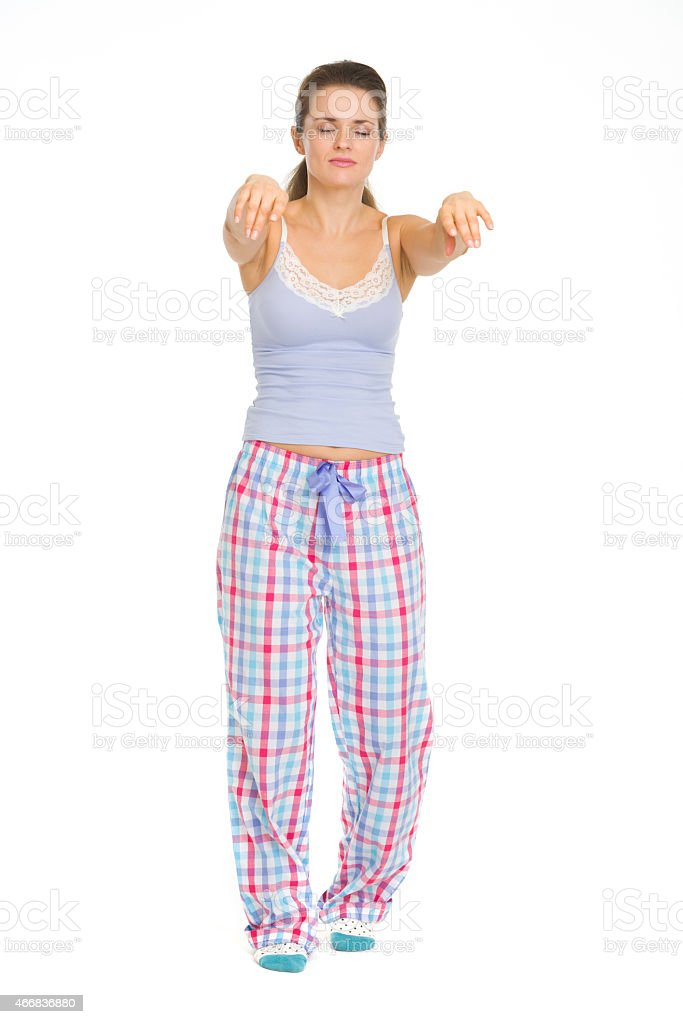 full length portrait of young woman in pajamas sleep walking stock photo