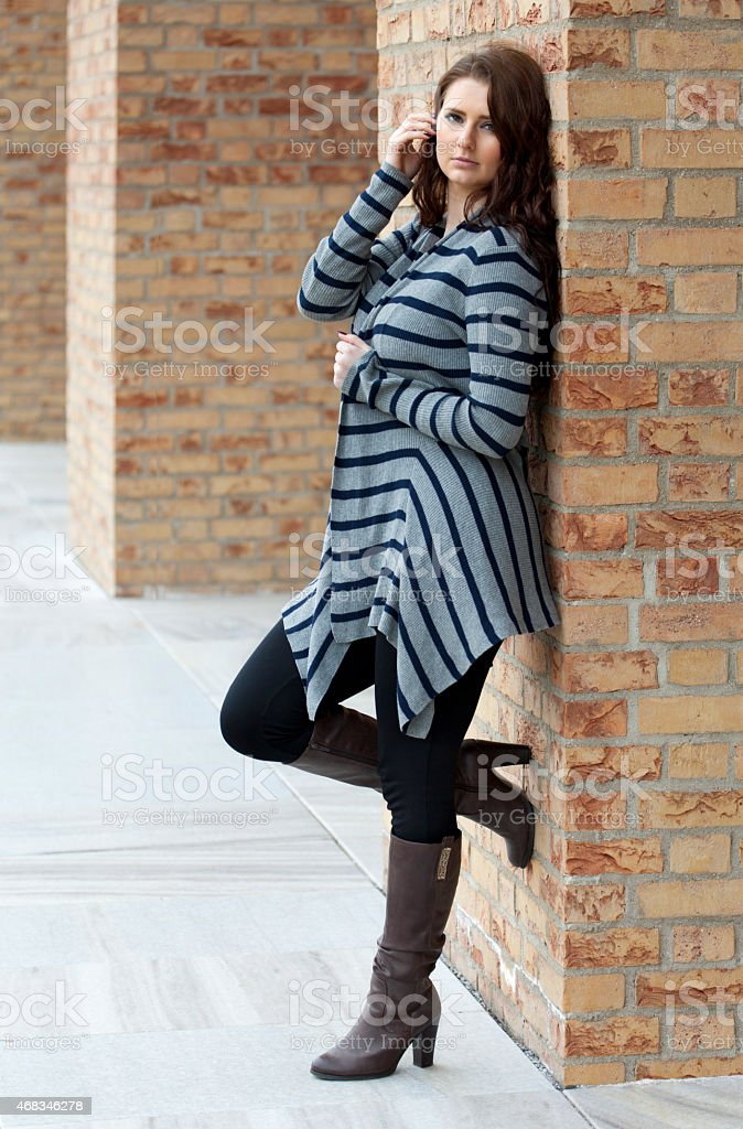 Full length portrait of young woman stock photo