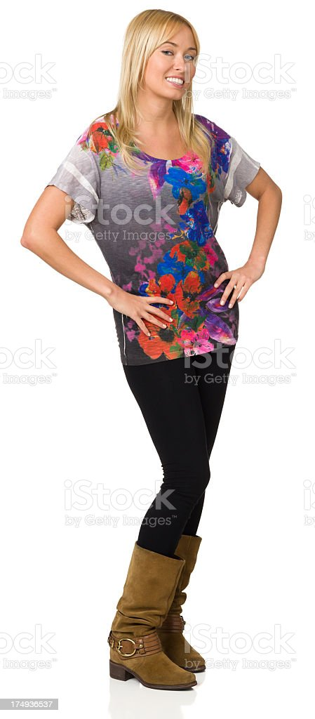 Full Length Portrait Of Young Woman With Arms Akimbo royalty-free stock photo