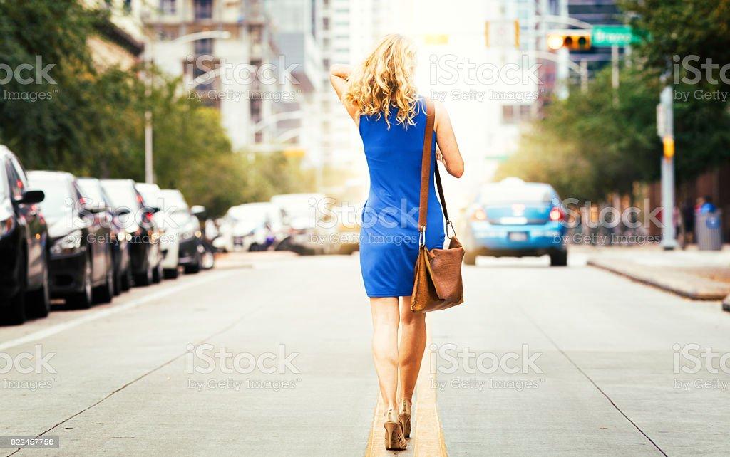 Full length rear view of woman walking in heels stock photo