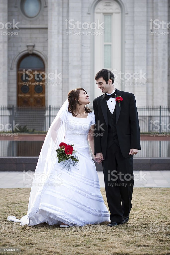 Full Length Romantic Bride and Groom Walking Talking Holding Hands royalty-free stock photo