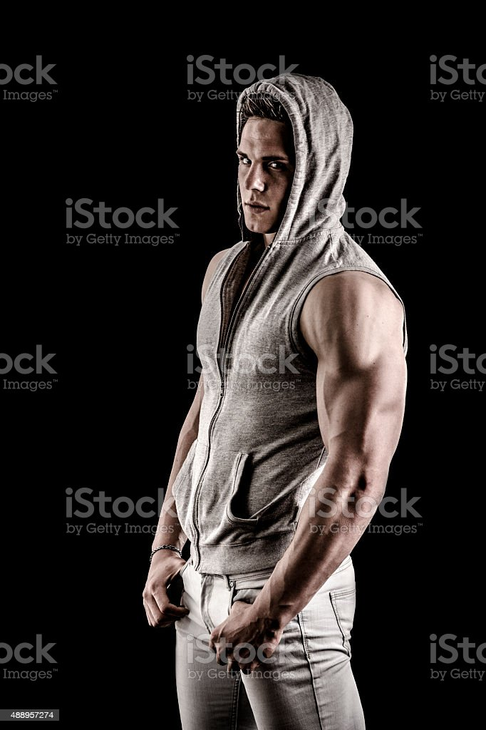 Full length shot of tough young man in dark t stock photo