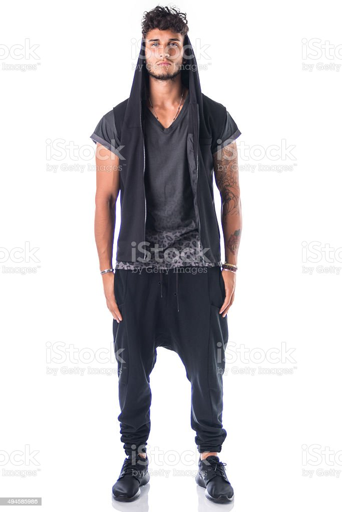 Full length shot of tough young man in dark t stock photo