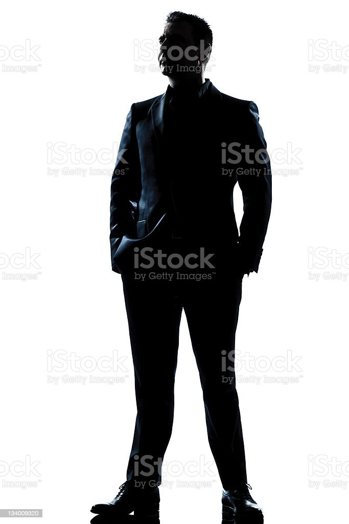 Full length silhouette of businessman in suit stock photo